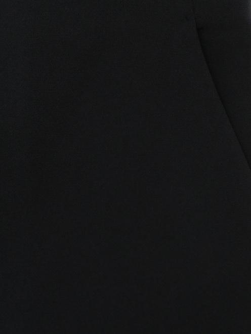 Укороченные брюки с боковыми карманами - Деталь